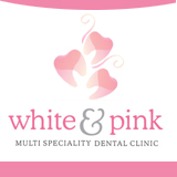 WHITE AND PINK MULTISPECIALITY DENTAL CLINIC